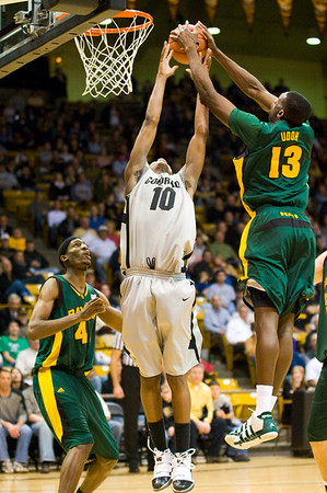 S0113CUBASKET05.jpg S0113CUBASKET05<br /> Cu's #10, Alec Burks and Baylor's #13, Ekpe Uduh go up for a rebound during CU's 78-71 victory at the Coors Event Center in Boulder Colorado on Tuesday evening, January 12th, 2010.<br /> <br /> Photo by: Jonathan Castner