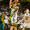 S0113CUBASKET06.jpg S0113CUBASKET06<br /> Cu's #10, Alec Burks is foulded while going to the hoop by Baylor's 450, Josh Lomers during CU's 78-71 victory at the Coors Event Center in Boulder Colorado on Tuesday evening, January 12th, 2010.<br /> <br /> Photo by: Jonathan Castner