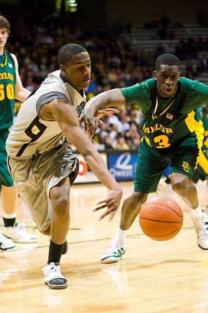S0113CUBASKET07.jpg S0113CUBASKET07<br /> Cu's #10, Alec Burks and Baylors' # Ekpe Udoh scramble for a loose ball during CU's 78-71 victory at the Coors Event Center in Boulder Colorado on Tuesday evening, January 12th, 2010.<br /> <br /> Photo by: Jonathan Castner