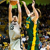 S0113CUBASKET02.jpg S0113CUBASKET02<br /> Cu's #12, Shane Harris-Tunks slams one in as Baylor's #50,Josh Lomers defends during CU's 78-71 victory at the Coors Event Center in Boulder Colorado on Tuesday evening, January 12th, 2010.<br /> <br /> Photo by: Jonathan Castner