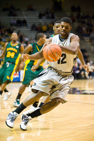 S0113CUBASKET03.jpg S0113CUBASKET03<br /> Cu's #12, Dwight Thorne II, grabs a loose  ball during CU's 78-71 victory at the Coors Event Center in Boulder Colorado on Tuesday evening, January 12th, 2010.<br /> <br /> Photo by: Jonathan Castner