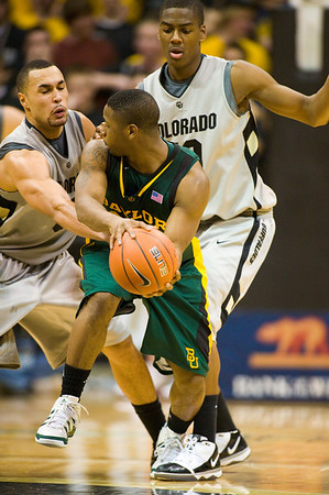 S0113CUBASKET09.jpg S0113CUBASKET09<br /> Cu's #10, Alec Burks and #5, Marcus Relphorde double team Baylor's #45, Tweedy Carter during CU's 78-71 victory at the Coors Event Center in Boulder Colorado on Tuesday evening, January 12th, 2010.<br /> <br /> Photo by: Jonathan Castner