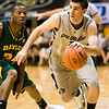 S0113CUBASKET01.jpg S0113CUBASKET01<br /> Cu's #1, Nate Tomlinson drives to the hoop as Baylor's #24,  Lacedarius Dunn defends during CU's 78-71 victory at the Coors Event Center in Boulder Colorado on Tuesday evening, January 12th, 2010.<br /> <br /> Photo by: Jonathan Castner