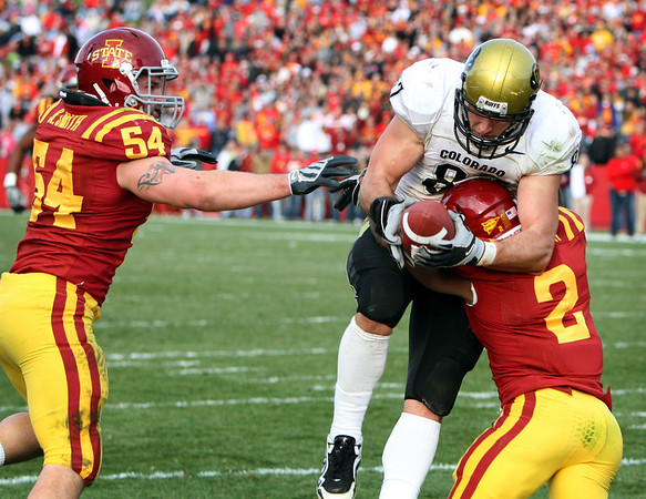 Iowa State's James Smith (2) breaks up a pass intended for Colorado's Riar Geer as Iowa State's Jesse Smith, left, looks on during the third quarter of an NCAA college football game, Saturday, Nov. 14, 2009, in Ames, Iowa. Iowa State won 17-10. (AP Photo/Charlie Neibergall)