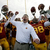 Iowa State coach Paul Rhoads, center, celebrates with his team after their 17-10 win over Colorado in an NCAA college football game, Saturday, Nov. 14, 2009, in Ames, Iowa. (AP Photo/Charlie Neibergall)