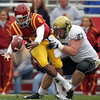 Iowa State quarterback Austen Arnaud loses the ball as he is sacked by Colorado's Will Pericak, right, during the first quarter of an NCAA college football game, Saturday, Nov. 14, 2009, in Ames, Iowa. (AP Photo/Charlie Neibergall)