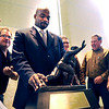 CUFootball011Recruiting.JPG Former CU Buff and Heisman Trophy winner Rashaan Salaam stands in front of his trophy before taking group pictures during the University of Colorado Football Preview Luncheon on Thursday, Feb. 3, at the Hyatt Regency Denver Convention Center in Denver.<br /> Photo by Jeremy Papasso