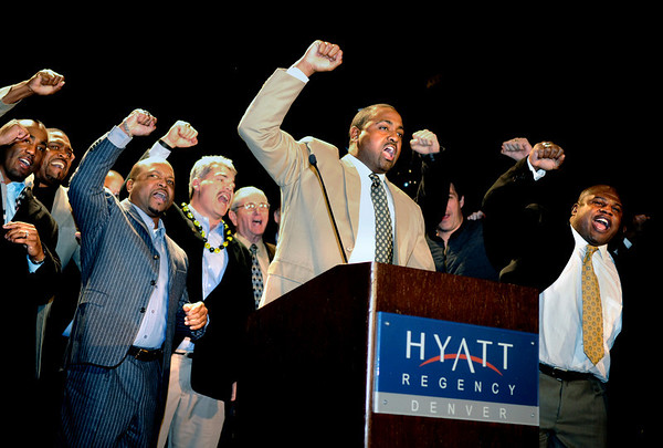 "CUFootball007Recruiting.JPG University of Colorado football coaching staff Darian Hagan, left, Brian Cabral, Bill McCartney, Jon Embree, and Eric Bieniemy chant the CU fight song at the end of the University of Colorado Football Preview Luncheon on Thursday, Feb. 3, at the Hyatt Regency Denver Convention Center in Denver. For a video and photos of the event go to  <a href=""http://www.dailycamera.com"">http://www.dailycamera.com</a><br /> Photo by Jeremy Papasso"