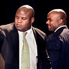 CUFootball004Recruiting.JPG University of Colorado offensive coordinator Eric Bieniemy, left, waits at the podium for former Buff and Heisman Trophy winner Rashaan Salaam, right, during the University of Colorado Football Preview Luncheon on Thursday, Feb. 3, at the Hyatt Regency Denver Convention Center in Denver.<br /> Photo by Jeremy Papasso