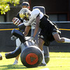 """Ayodeji Olatoye, 25, attacks a practice dummy during practice on Sunday morning on the CU Boulder Campus.<br /> Photo by Paul Aiken  August 7, 2011.<br /> FOR MORE PHOTOS AND VIDEO INTERVIEWS FROM PRACTICE GO TO  <a href=""""http://WWW.DAILYCAMERA.COM"""">http://WWW.DAILYCAMERA.COM</a>"""
