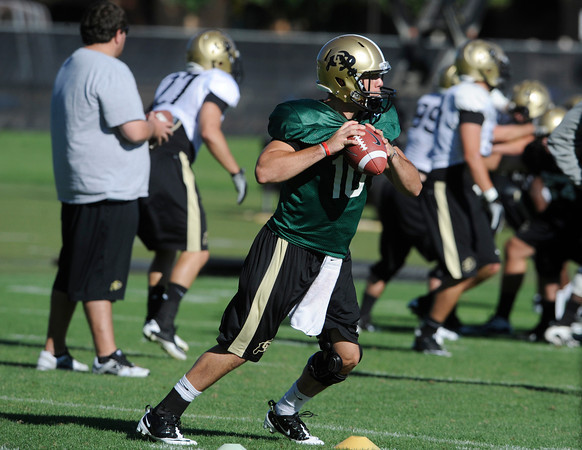 "Brent Burnette, 10, moves around cones in a quarterback footwork drill during practice on Sunday morning on the CU Boulder Campus. FOR MORE PHOTOS AND VIDEO INTERVIEWS FROM PRACTICE GO TO  <a href=""http://WWW.DAILYCAMERA.COM"">http://WWW.DAILYCAMERA.COM</a><br /> Photo by Paul Aiken  August 7, 2011."
