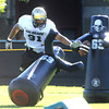 "Kirk Poston, 91, works his way through tackling dummies during practice on Sunday morning on the CU Boulder Campus. FOR MORE PHOTOS AND VIDEO INTERVIEWS FROM PRACTICE GO TO  <a href=""http://WWW.DAILYCAMERA.COM"">http://WWW.DAILYCAMERA.COM</a><br /> Photo by Paul Aiken  August 7, 2011."