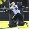 "River Thompson, 38, attacks a practice dummy during drills on Sunday morning on the CU Boulder Campus.<br /> Photo by Paul Aiken  August 7, 2011.<br /> FOR MORE PHOTOS AND VIDEO INTERVIEWS FROM PRACTICE GO TO  <a href=""http://WWW.DAILYCAMERA.COM"">http://WWW.DAILYCAMERA.COM</a>"