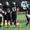 "Rodney Stewart, 5, at right work on footwork drills during practice on Sunday morning on the CU Boulder Campus. Watching from left to right are Brian Lockridge, 20, Josh Ford, 42, and Malcolm Creer, 44.<br /> Photo by Paul Aiken  August 7, 2011.<br /> FOR MORE PHOTOS AND VIDEO INTERVIEWS FROM PRACTICE GO TO  <a href=""http://WWW.DAILYCAMERA.COM"">http://WWW.DAILYCAMERA.COM</a>"