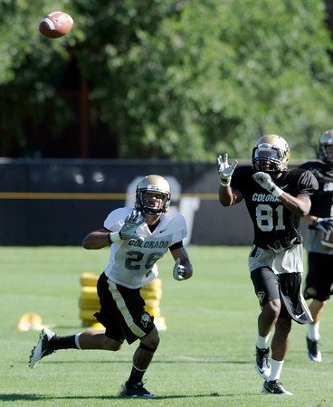 "Ray Polk, 26, covers Austin Vincent, 81, during practice on Sunday morning on the CU Boulder Campus. FOR MORE PHOTOS AND VIDEO INTERVIEWS FROM PRACTICE GO TO  <a href=""http://WWW.DAILYCAMERA.COM"">http://WWW.DAILYCAMERA.COM</a><br /> Photo by Paul Aiken  August 7, 2011."