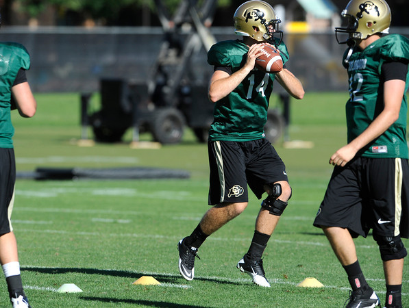 "John Schrock moves around cones in a quarterback footwork drill during practice on Sunday morning on the CU Boulder Campus. FOR MORE PHOTOS AND VIDEO INTERVIEWS FROM PRACTICE GO TO  <a href=""http://WWW.DAILYCAMERA.COM"">http://WWW.DAILYCAMERA.COM</a><br /> Photo by Paul Aiken  August 7, 2011."