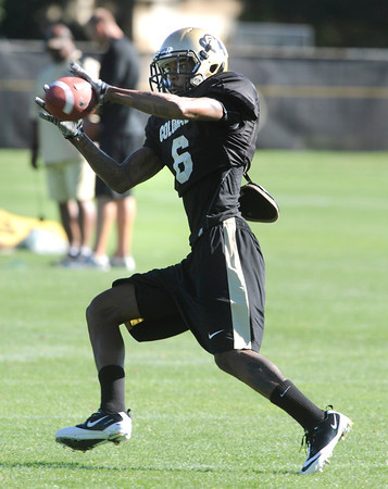 "Paul Richardson, 6, reaches for the ball during practice on Sunday morning on the CU Boulder Campus.<br /> FOR MORE PHOTOS AND VIDEO INTERVIEWS FROM PRACTICE GO TO  <a href=""http://WWW.DAILYCAMERA.COM"">http://WWW.DAILYCAMERA.COM</a><br /> Photo by Paul Aiken  August 7, 2011."
