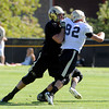 "Alex Lewis, 85, fends off Casey Walker, 92,  during practice on Sunday morning on the CU Boulder Campus. FOR MORE PHOTOS AND VIDEO INTERVIEWS FROM PRACTICE GO TO  <a href=""http://WWW.DAILYCAMERA.COM"">http://WWW.DAILYCAMERA.COM</a><br /> Photo by Paul Aiken  August 7, 2011."