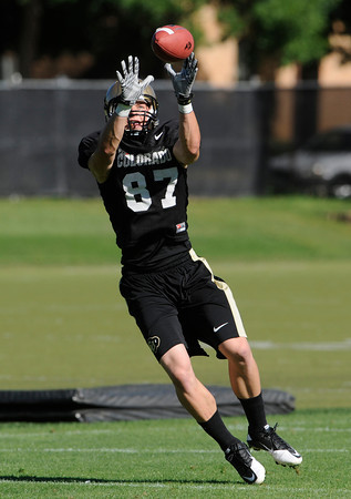 "Tyler McCulloch, 87, reaches for the ball during practice on Sunday morning on the CU Boulder Campus.<br /> Photo by Paul Aiken  August 7, 2011.<br /> FOR MORE PHOTOS AND VIDEO INTERVIEWS FROM PRACTICE GO TO  <a href=""http://WWW.DAILYCAMERA.COM"">http://WWW.DAILYCAMERA.COM</a>"