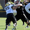 """Jack Harris, 75, fends off Torny Poremba, 95, during practice on Sunday morning on the CU Boulder Campus. FOR MORE PHOTOS AND VIDEO INTERVIEWS FROM PRACTICE GO TO  <a href=""""http://WWW.DAILYCAMERA.COM"""">http://WWW.DAILYCAMERA.COM</a><br /> Photo by Paul Aiken  August 7, 2011."""