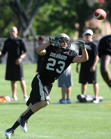 "Parker Norton, 23, reaches for the ball during practice on Sunday morning on the CU Boulder Campus.<br /> Photo by Paul Aiken  August 7, 2011.<br /> FOR MORE PHOTOS AND VIDEO INTERVIEWS FROM PRACTICE GO TO  <a href=""http://WWW.DAILYCAMERA.COM"">http://WWW.DAILYCAMERA.COM</a>"