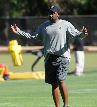 "Head Coach Jon Embree isn't happy with what he sees in a drill during practice on Sunday morning on the CU Boulder Campus.<br /> FOR MORE PHOTOS AND VIDEO INTERVIEWS FROM PRACTICE GO TO  <a href=""http://WWW.DAILYCAMERA.COM"">http://WWW.DAILYCAMERA.COM</a><br /> Photo by Paul Aiken  August 7, 2011."