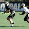 "Logan Gray, 2, pulls the ball in while being covered by Makiri Pugh, 16,  during practice on Sunday morning on the CU Boulder Campus. FOR MORE PHOTOS AND VIDEO INTERVIEWS FROM PRACTICE GO TO  <a href=""http://WWW.DAILYCAMERA.COM"">http://WWW.DAILYCAMERA.COM</a><br /> Photo by Paul Aiken  August 7, 2011."