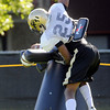 "Ayodeji Olatoye, 25, attacks a practice dummy during practice on Sunday morning on the CU Boulder Campus.<br /> Photo by Paul Aiken  August 7, 2011.<br /> FOR MORE PHOTOS AND VIDEO INTERVIEWS FROM PRACTICE GO TO  <a href=""http://WWW.DAILYCAMERA.COM"">http://WWW.DAILYCAMERA.COM</a>"