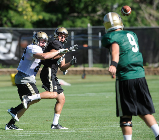 "Arthur Jaffee, 22, covers Alex Turbox, 86, on a pass from Tyler Hansen, 9, during practice on Sunday morning on the CU Boulder Campus. FOR MORE PHOTOS AND VIDEO INTERVIEWS FROM PRACTICE GO TO  <a href=""http://WWW.DAILYCAMERA.COM"">http://WWW.DAILYCAMERA.COM</a><br /> Photo by Paul Aiken  August 7, 2011."