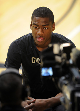 "Alec Burks talks to a television station before Tuesday's practice.<br /> For more photos and a video interview, go to  <a href=""http://www.dailycamera.com"">http://www.dailycamera.com</a>.<br /> Cliff Grassmick / March 15, 2011"