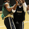 """Javon Coney, left, guards Cory Higgins during CU's NIT practice.<br /> For more photos and a video interview, go to  <a href=""""http://www.dailycamera.com"""">http://www.dailycamera.com</a>.<br /> Cliff Grassmick / March 15, 2011"""