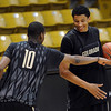 "Alec Burks (10) and Andre Roberson, have some fun in practice.<br /> For more photos and a video interview, go to  <a href=""http://www.dailycamera.com"">http://www.dailycamera.com</a>.<br /> Cliff Grassmick / March 15, 2011"