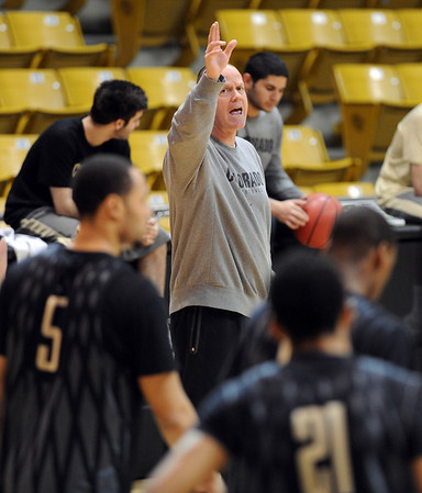 "Colorado head basketball coach, Tad Boyle, works his players during preparation for the first game of the NIT. The Buffs play Texas Southern on Wednesday night.<br /> For more photos and a video interview, go to  <a href=""http://www.dailycamera.com"">http://www.dailycamera.com</a>.<br /> Cliff Grassmick / March 15, 2011"