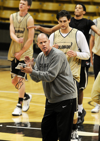 """Colorado head basketball coach, Tad Boyle, works his players during preparation for the first game of the NIT. The Buffs play Texas Southern on Wednesday night.<br /> For more photos and a video interview, go to  <a href=""""http://www.dailycamera.com"""">http://www.dailycamera.com</a>.<br /> Cliff Grassmick / March 15, 2011"""
