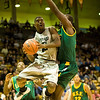 S1202CUBASKET5.jpg F1202CUBASKET5<br /> <br /> CU's #12, Dwight Thorns II drives to the hoop with pressure by San Francisco's #21, Mostapha Diarra.  CU won 78-54 over San Francisco.<br /> <br /> <br /> Photo by: Jonathan Castner