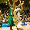 S1202CUBASKET3.jpg F1202CUBASKET3<br /> <br /> CU's #10, Alec Burks drives to the hoop and is blocked by San Francisco's #11, Dontae Bryant for a foul.  CU won 78-54 over San Francisco.<br /> <br /> <br /> Photo by: Jonathan Castner