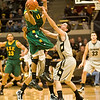 S1202CUBASKET4.jpg F1202CUBASKET4<br /> <br /> CU's #1, Nate Tomlinson puts pressure on San Francisco's #1, Kwame Vaughn.  CU won 78-54 over San Francisco.<br /> <br /> Photo by: Jonathan Castner