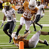 Texas' Fozzy Whittaker (28) leaps over teammate Colt McCoy to score a touchdown against Colorado  during the fourth quarter of their NCAA college football game in Austin, Texas, Saturday, Oct. 10, 2009. Texas won 38-14. (AP Photo/Eric Gay)