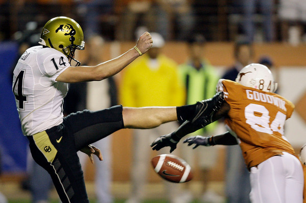 Texas'  Marquise Goodwin (84) blocks a punt by Colorado's Matt DiLallo (14) during the third quarter of their NCAA college football game in Austin, Texas, Saturday, Oct. 10, 2009. Texas recovered and scored a touchdown on the play. (AP Photo/Eric Gay)