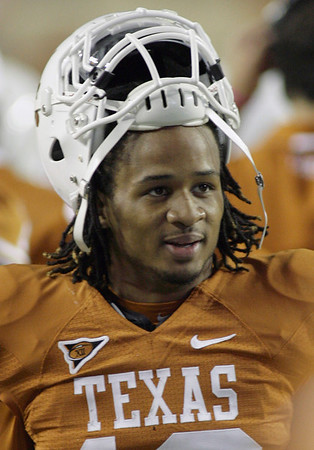Texas safety Earl Thomas takes a breather on the sideline shortly after he grabbed an interception and ran it back 92 yards for a touchdown during the third quarter of their NCAA college football game against Colorado Saturday, Oct. 10, 2009, in Austin, Texas. Texas won  38-14.  (AP Photo/Harry Cabluck)