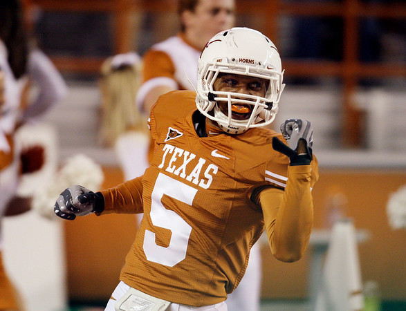 Texas' Ben Wells celebrates after he scored a touchdown on a blocked punt  during the fourth quarter of their NCAA college football game against Colorado in Austin, Texas, Saturday, Oct. 10, 2009. Texas won 38-14. (AP Photo/Eric Gay)