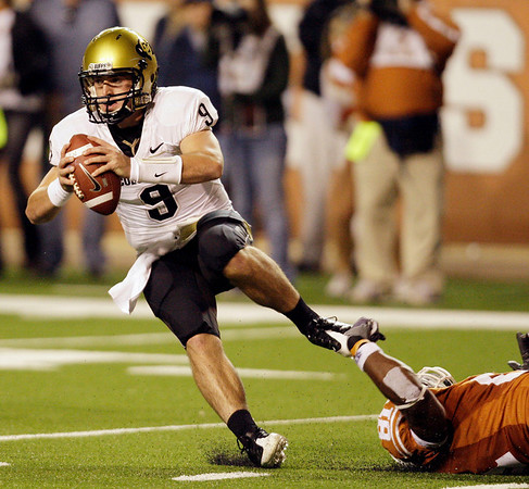 Colorado's Tyler Hansen (9) is tripped up by Texas defender Sam Acho (81) during the fourth quarter of their NCAA college football game in Austin, Texas, Saturday, Oct. 10, 2009. (AP Photo/Eric Gay)