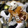 Texas wide receiver Jordan Shipley, right, looks for room to run after taking a punt and returning it 74-yards for a touchdown during the fourth quarter of their 38-14 NCAA college football victory over Colorado Saturday, Oct. 10, 2009, in Austin, Texas. Colorado Colorado defender is Marcus Burton, left.  (AP Photo/Harry Cabluck)