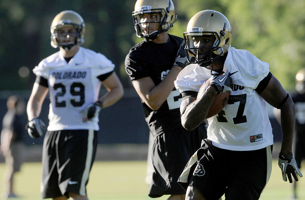 CU wide receiver Kendrick Celestine, at right, runs with the ball after making a catch during the second Buff's football practice on Friday, Aug. 6, at the University of Colorado practice field in Boulder.<br /> Jeremy Papasso/ Camera