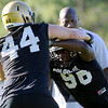 CU defensive end Chidera Uzo-Diribe, at right, puts a block on fellow defensive end Nick Kasa during the second Buff's football practice on Friday, Aug. 6, at the University of Colorado practice field in Boulder.<br /> Jeremy Papasso/ Camera