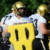 CU offensive lineman Blake Behrens, at front, gets ready to do some blocking drills during the second Buff's football practice on Friday, Aug. 6, at the University of Colorado practice field in Boulder.<br /> Jeremy Papasso/ Camera