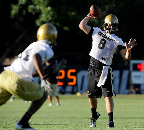 CU quarterback Nick Hirschman, at right, passes the ball to wide receiver Jon Major during the second Buff's football practice on Friday, Aug. 6, at the University of Colorado practice field in Boulder.<br /> Jeremy Papasso/ Camera