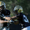 CU cornerback Paul Vigo, at right, practices his blocking on fellow cornerback Josh Moten during the second Buff's football practice on Friday, Aug. 6, at the University of Colorado practice field in Boulder.<br /> Jeremy Papasso/ Camera