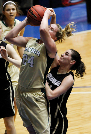 Baylor's Ashley Field (24) has her shot blocked from behind by Colorado's Meagan Malcolm-Peck in the first half of a college NCAA basketball game at the Big 12 Women's basketball tournament Thursday, March 11, 2010, in Kansas City, Mo.  (AP Photo/Ed Zurga)