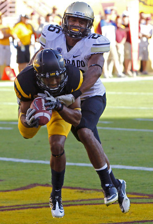 Arizona State's Kevin Ozier, front left, scores a touchdown on a pass in front of Colorado's Ray Polk (26) in the first quarter of an NCAA college football game Saturday, Oct. 29, 2011, in Tempe, Ariz. (AP Photo/Ross D. Franklin)